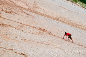Hiker has difficulty climbing up a sand dune at Sleeping Bear