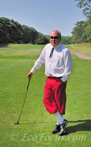 Golf director Greg Wall leaning on his club at Pocono Manor golf course