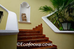 Stairway and statue of angel in alcove