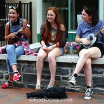 Three girls playing ukeleles at Old Town